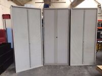 7 Ft BISLEY & TRIUMPH TAMBOUR CABINET WITH 4 SHELVES