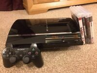 Excellent condition: Sony PlayStation 3 60GB Charcoal Black Console Plus 4 Games