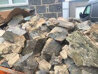 Granite stones some dressed free to uplift