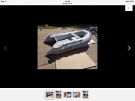 Inflatable dinghy 2.7m. Bought new, used twice perfect cond. sell/Swap. retractable wheels