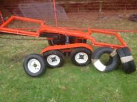 Four wheel braked towing dolly