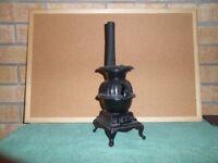 Pot belly stove, cast iron, colour black.
