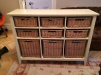 Lovely storage table with wicker baskets