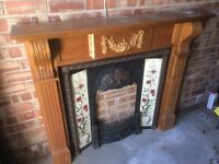Reproduction Victorian cast iron fire and wooden surround