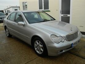 Mercedes C200 Kompressor Petrol 2.0 litre. Silver with grey cloth interior 110000 miles