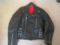 Vintage black leather motorbike jacket with red lining zips and buckles