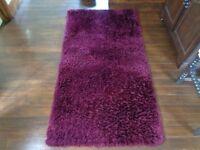 Plum shaggy rug x2