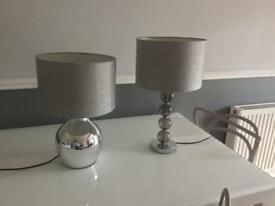 Two lamps with grey linen shades