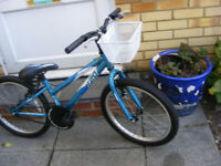 "GIRLS 20"" WHEEL BIKE WITH FITTED BASKET IN GREAT WORKING ORDER AGE 7+"