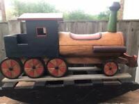 Large wooden rocking train
