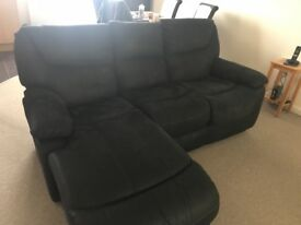 Almost new black reclining sofa with chaise