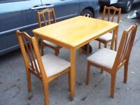 Solid wooden dining table and four chairs with upsholstered seats