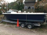 22 ft Fast Fisher boat with double axle galvanised trailer.