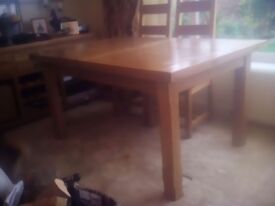 Solid oak extending dining table, very heavy, in excellent condition