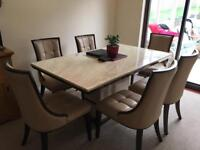Large marble dining room table and chairs