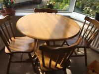 Round pine dining table with 4x matching chairs, delivery possible