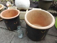 Pair of decorated garden plant pots