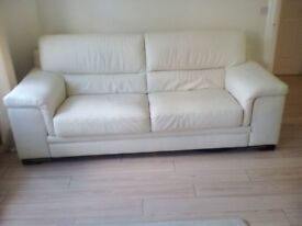 Two cream leather settees three seaters 7 foot wide