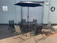 Black garden furniture table & 6x chairs plus canopy