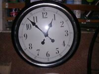 Black wall clock in very good condition, battery powered 17 inches in diameter