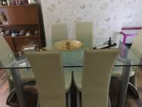 Double glass table with 6 chairs