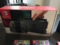 Nintendo Switch + 3 Games (Zelda, Mario, Mario Kart)