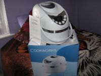 Breadmaker,never been used,complete with instruction manual,pickup only Walker area