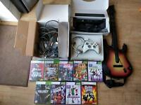 Xbox 360 with Kinect and 9 games and guitar hero controller