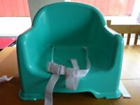 Childs booster seat, for feeding. Green, plastic, from Mothercare. £5