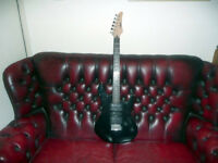 Black Yamaha electric guitar , new strings , good working order
