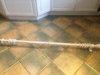 Distressed white curtain pole