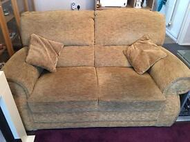 Light mustard 2 two seat sofas + storage footstool suite.