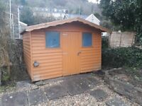 Free to collector wooden shiplap Garden Shed/playhouse 10ft by 8ft good condition