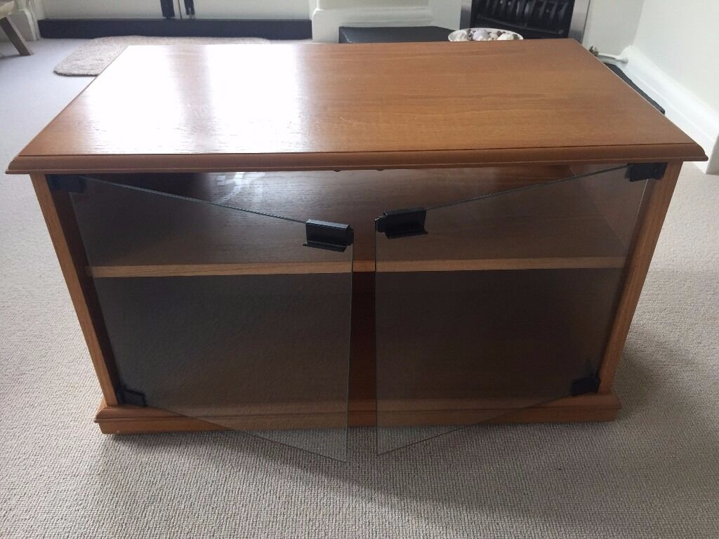 Retro TV Standin Kingston, LondonGumtree - Retro wooden TV stand with glass doors and shelf. Am not sure of the wood but I think it might be Teak. 70inches wide, 45inches deep, 41inches high. Excellent condition. Priced to sell