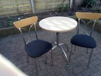 Small beech effect kitchen table and two chairs