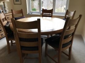 Beautiful Solid Oak round dining room table with 6 chairs and solid oak sideboard