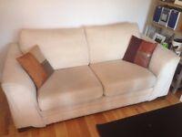 2 seat cream sofa