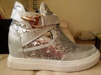 Silver wedge trainers size 4.