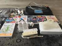 Nintendo Wii (comes with games, chargers ect)