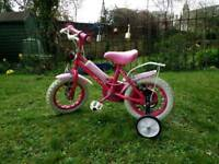 Pink 12 inch bike with stabilisers