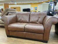 Brown leather two and three seater sofas. Excellent condition