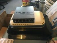 Netgear routers with power supply and ethernet cables