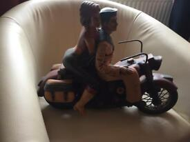 Beautiful large wooden motorcycle with sailor and lady on