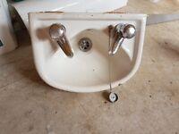 Small cream bathroom sink