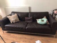 Dark brown 3 seated faux sofa