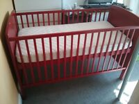 Red cot bed with mattress and bedding