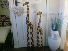 Two large wooden giraffes.