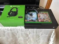 Xbox one 500gb with GTA V, Star Wars Battlefront and official xbox one stereo headset (with adapter)