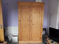very good condition. not flat pack. strong and sturdy antique pine double wardrobe