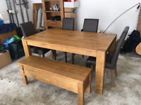 Extendable Dining Table with 4 Leather Chairs and Bench. Bought from next home. Excellent condition.